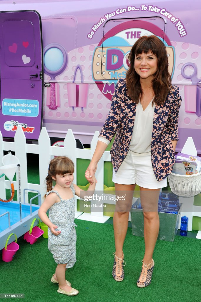 Actress Tiffani Thiessen (R) and daughter Harper Smith attend the Doc Mobile Tour at the Disney Store on August 21, 2013 in New York City.