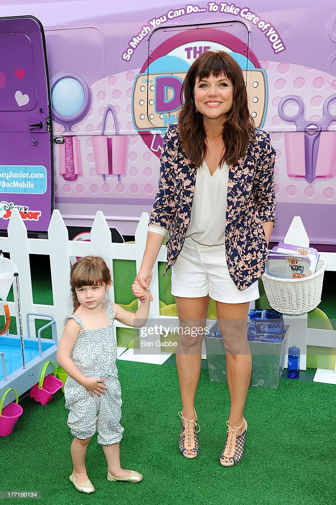 Actress <a gi-track='captionPersonalityLinkClicked' href=/galleries/search?phrase=Tiffani+Thiessen&family=editorial&specificpeople=221649 ng-click='$event.stopPropagation()'>Tiffani Thiessen</a> (R) and daughter Harper Smith attend the Doc Mobile Tour at the Disney Store on August 21, 2013 in New York City.
