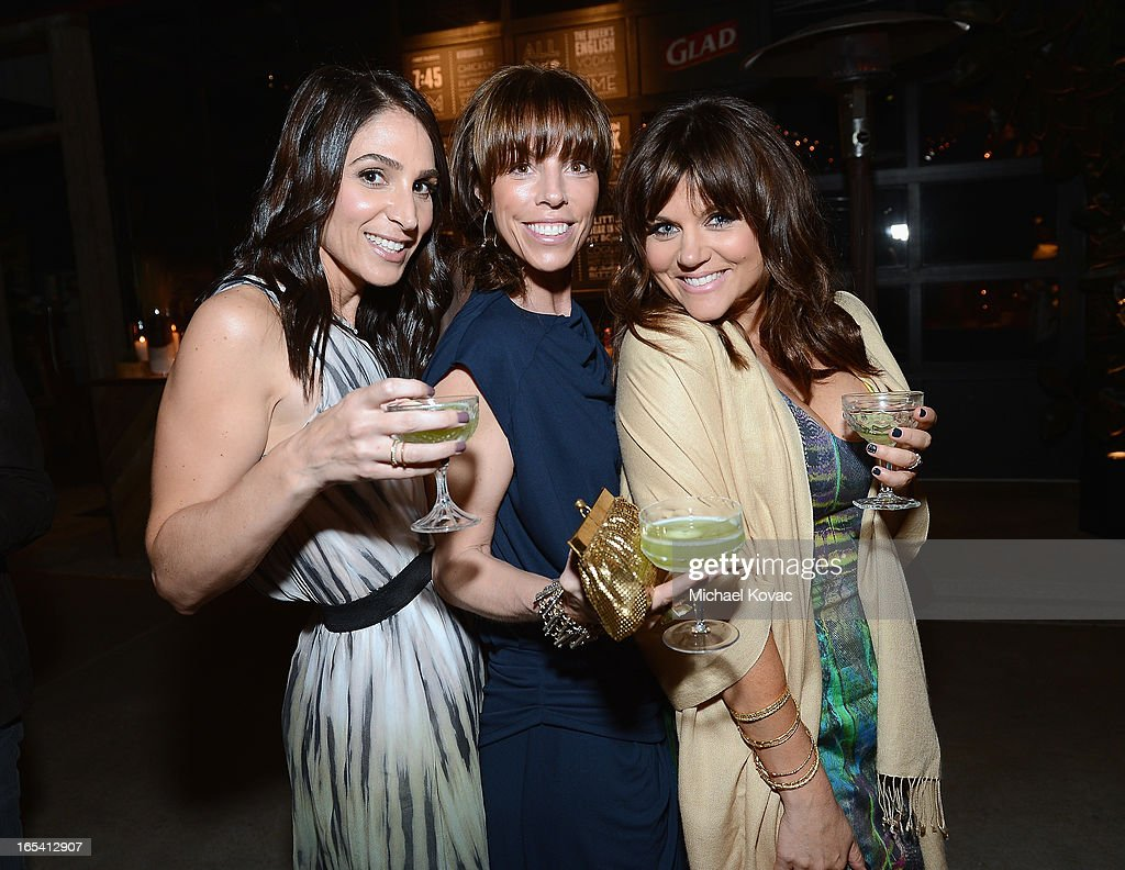 Actress <a gi-track='captionPersonalityLinkClicked' href=/galleries/search?phrase=Tiffani+Thiessen&family=editorial&specificpeople=221649 ng-click='$event.stopPropagation()'>Tiffani Thiessen</a> and friends Karen Zambos and Lesley Feldman toast at her One Bag Party, sponsored by Glad Trash, where just one bag of trash went to landfill waste and the rest was recycled or composted at The Smog Shoppe on April 3, 2013 in Los Angeles, California.