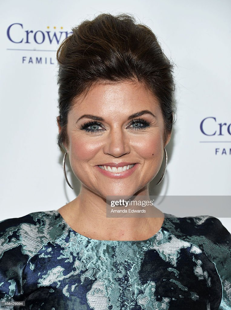 Actress Tiffani Thiessen arrives at the Hallmark Channel's Holiday Christmas world premiere screening of 'Northpole' at La Piazza Restaurant on...