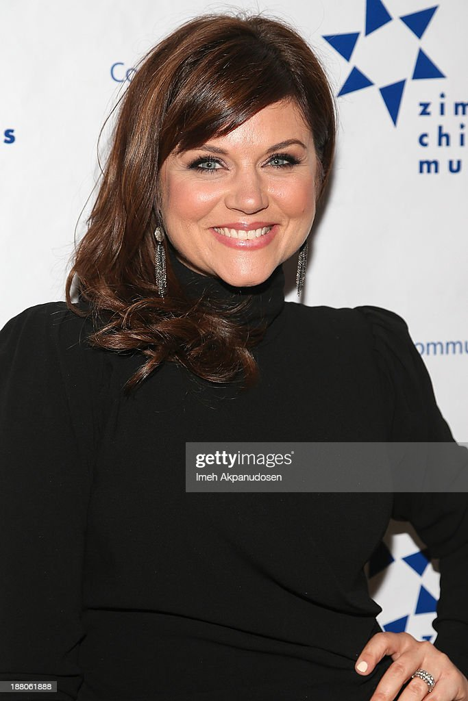 Actress <a gi-track='captionPersonalityLinkClicked' href=/galleries/search?phrase=Tiffani+Thiessen&family=editorial&specificpeople=221649 ng-click='$event.stopPropagation()'>Tiffani Thiessen</a> attends the 13th Annual Discovery Award Dinner presented by the Zimmer Children's Museum at Beverly Hills Hotel on November 14, 2013 in Beverly Hills, California.