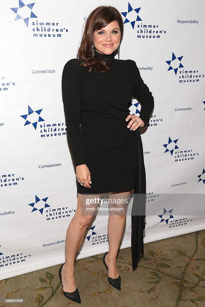 Actress Tiffani Thiessen attends the 13th Annual Discovery Award Dinner presented by the Zimmer Children's Museum at Beverly Hills Hotel on November...