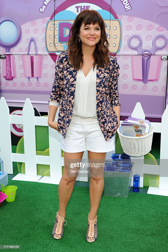 Actress <a gi-track='captionPersonalityLinkClicked' href=/galleries/search?phrase=Tiffani+Thiessen&family=editorial&specificpeople=221649 ng-click='$event.stopPropagation()'>Tiffani Thiessen</a> attends the Doc Mobile Tour at the Disney Store on August 21, 2013 in New York City.
