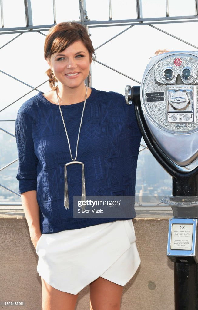 Actress <a gi-track='captionPersonalityLinkClicked' href=/galleries/search?phrase=Tiffani+Thiessen&family=editorial&specificpeople=221649 ng-click='$event.stopPropagation()'>Tiffani Thiessen</a> lights the Empire State building 'Jumpstart Red' to celebrate Jumpstart's Read For The Record Campaign on October 2, 2013 in New York City.