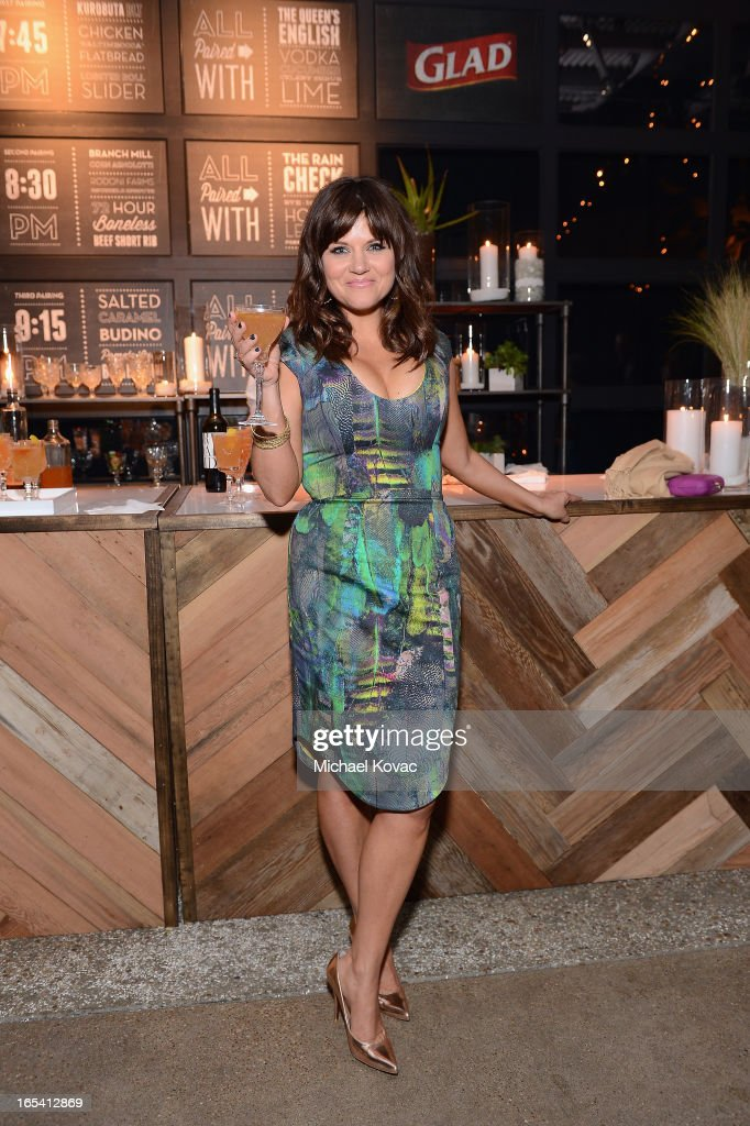 Actress <a gi-track='captionPersonalityLinkClicked' href=/galleries/search?phrase=Tiffani+Thiessen&family=editorial&specificpeople=221649 ng-click='$event.stopPropagation()'>Tiffani Thiessen</a> poses at her One Bag Party, sponsored by Glad Trash's One Bag Campaign at The Smog Shoppe on April 3, 2013 in Los Angeles, California. More than 50 of her friends attended the intimate get together, where just one bag of trash went to landfill waste and the rest was recycled or composted.