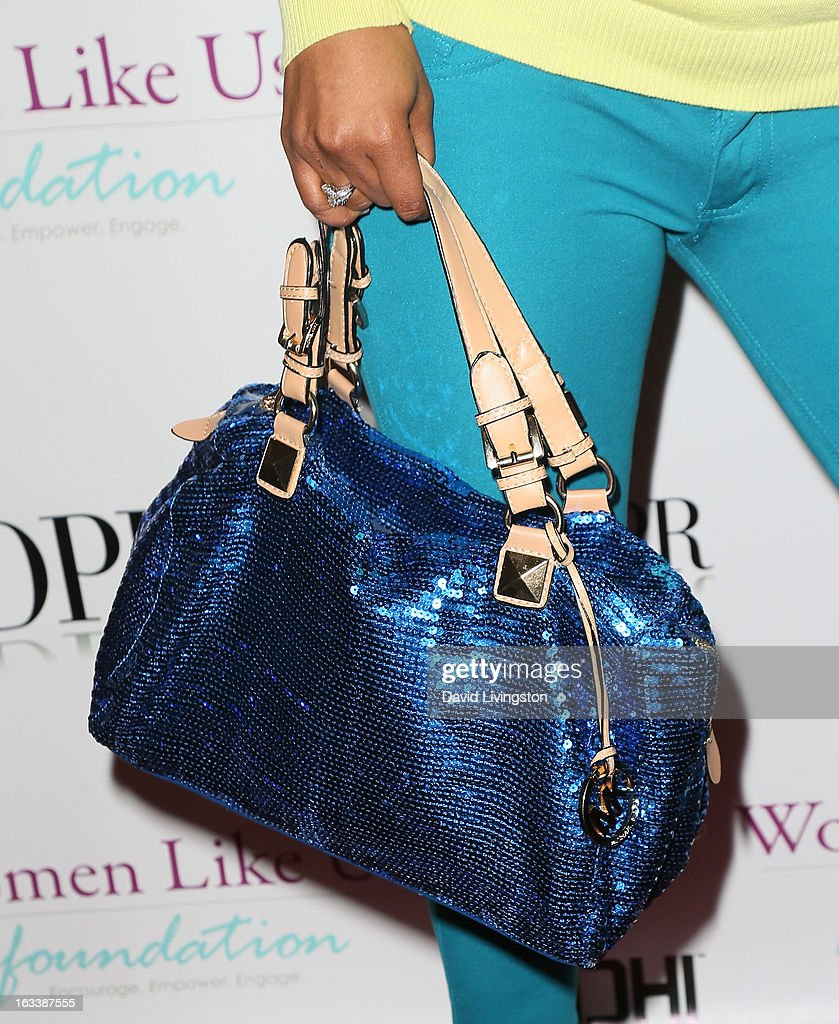 Actress Tiffany Haddish (purse detail) attends a Pre-LAFW benefit in support of the Women Like Us Foundation at Lexington Social House on March 8, 2013 in Hollywood, California.