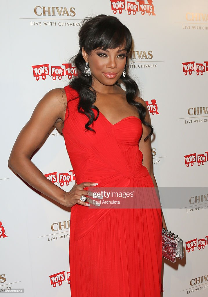 Actress Tiffany Hines attends the 'Under The Mistletoe' charity event benefiting the Toys For Tots Foundation at the Lexington Social House on December 14, 2012 in Hollywood, California.