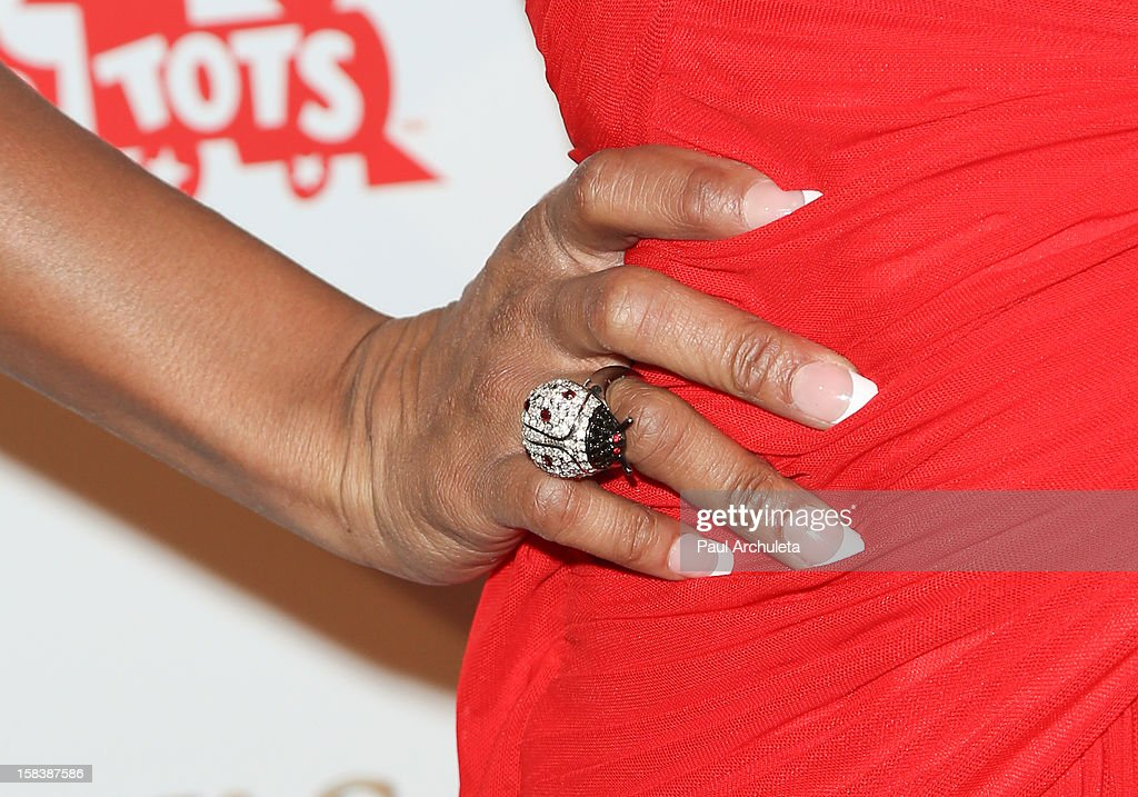 Actress Tiffany Hines (Jewelry detail) attends the 'Under The Mistletoe' charity event benefiting the Toys For Tots Foundation at the Lexington Social House on December 14, 2012 in Hollywood, California.