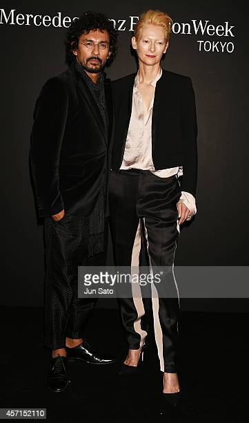Actress Tilda Swinton and designer Haider Ackermann attend the opening ceremony of MercedesBenz Fashion Week TOKYO 2015 S/S on October 13 2014 in...