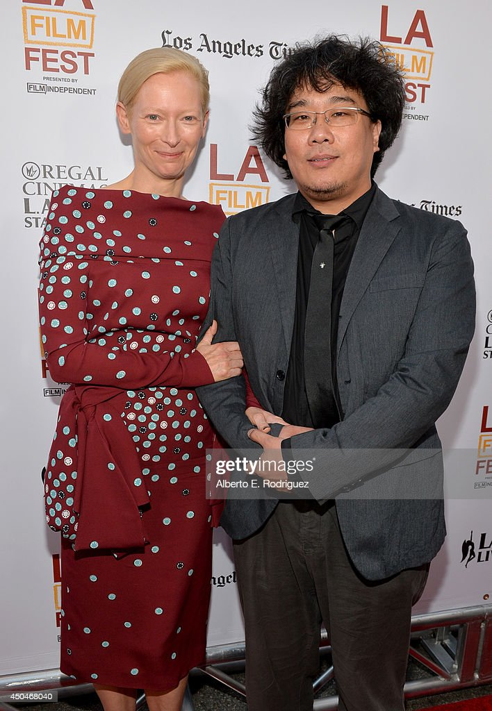 Actress <a gi-track='captionPersonalityLinkClicked' href=/galleries/search?phrase=Tilda+Swinton&family=editorial&specificpeople=202991 ng-click='$event.stopPropagation()'>Tilda Swinton</a> (L) and director Joon-ho Bong (R) attend the opening night premiere of 'Snowpiercer' during the 2014 Los Angeles Film Festival at Regal Cinemas L.A. Live on June 11, 2014 in Los Angeles, California.