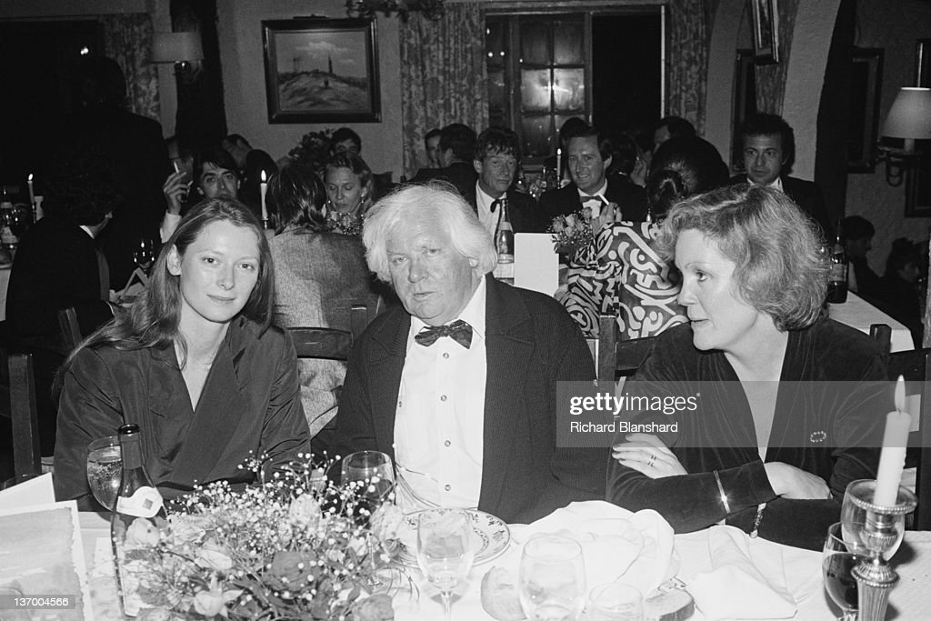 Actress Tilda Swinton (left) and director Ken Russell (1927 - 2011) at the Cannes Film Festival, France, to present their film 'Aria', May 1987. Actor John Hurt is visible in the background.
