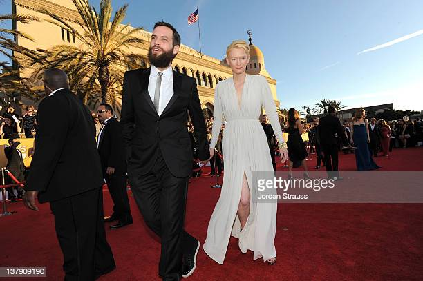 Actress Tilda Swinton and Sandro Kopp arrive at The 18th Annual Screen Actors Guild Awards broadcast on TNT/TBS at The Shrine Auditorium on January...