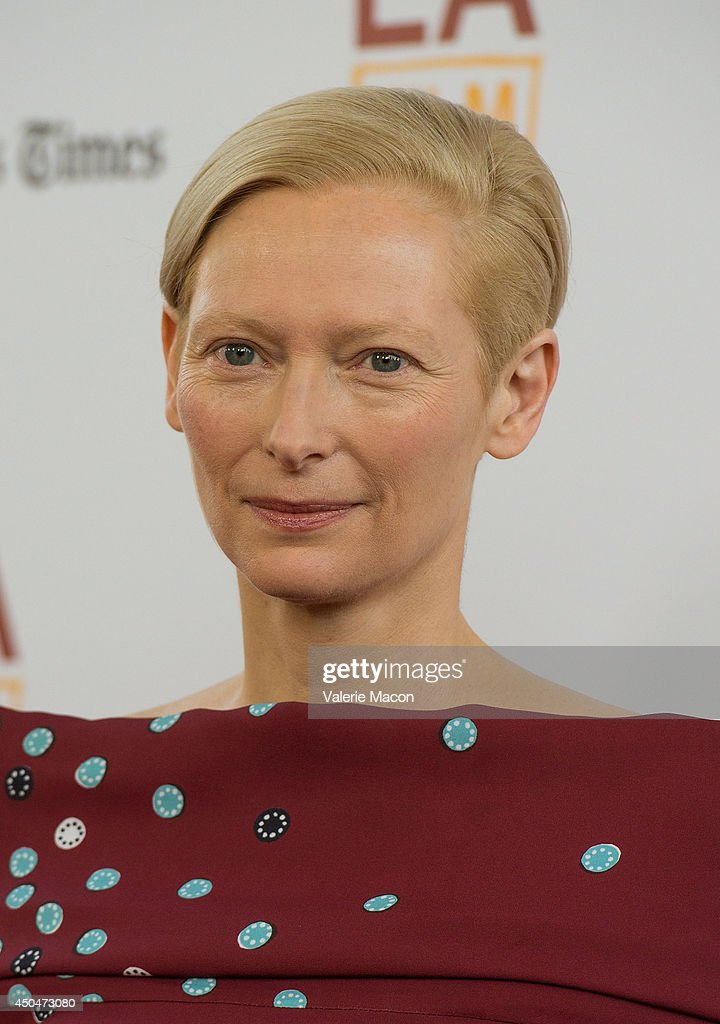 Actress <a gi-track='captionPersonalityLinkClicked' href=/galleries/search?phrase=Tilda+Swinton&family=editorial&specificpeople=202991 ng-click='$event.stopPropagation()'>Tilda Swinton</a> arrives at the 2014 Los Angeles Film Festival - Opening Night Premiere Of 'Snowpiercer' at Regal Cinemas L.A. Live on June 11, 2014 in Los Angeles, California.