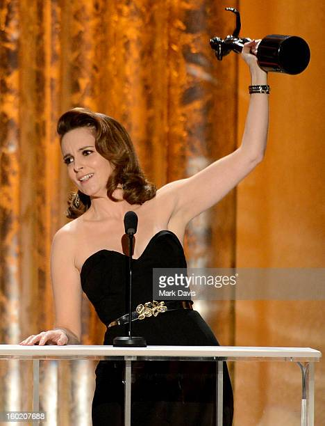 Actress Tina Fey accepts the award for Outstanding Performance by a Female Actor in a Comedy Series for '30 Rock' onstage during the 19th Annual...