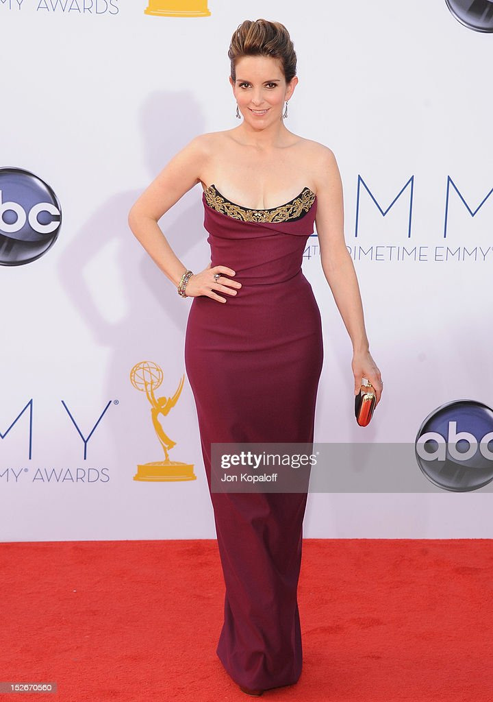Actress <a gi-track='captionPersonalityLinkClicked' href=/galleries/search?phrase=Tina+Fey&family=editorial&specificpeople=206753 ng-click='$event.stopPropagation()'>Tina Fey</a> arrives at the 64th Primetime Emmy Awards at Nokia Theatre L.A. Live on September 23, 2012 in Los Angeles, California.