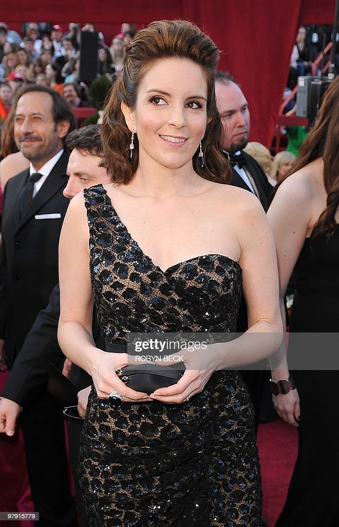 Actress <a gi-track='captionPersonalityLinkClicked' href=/galleries/search?phrase=Tina+Fey&family=editorial&specificpeople=206753 ng-click='$event.stopPropagation()'>Tina Fey</a> arrives at the 82nd Academy Awards at the Kodak Theater in Hollywood, California on March 07, 2010. AFP PHOTO Robyn BECK