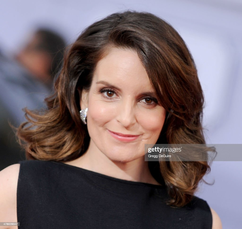 Actress Tina Fey arrives at the Los Angeles premiere of 'Muppets Most Wanted' at the El Capitan Theatre on March 11, 2014 in Hollywood, California.