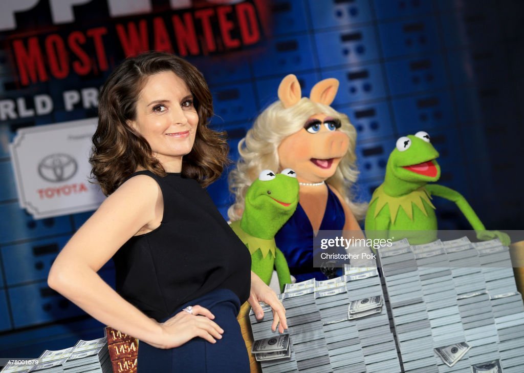 Actress <a gi-track='captionPersonalityLinkClicked' href=/galleries/search?phrase=Tina+Fey&family=editorial&specificpeople=206753 ng-click='$event.stopPropagation()'>Tina Fey</a>, Constantine, Miss Piggy and Kermit the Frog arrive at the world premiere of Disney's 'Muppets Most Wanted' at the El Capitan Theatre on March 11, 2014 in Hollywood, California.