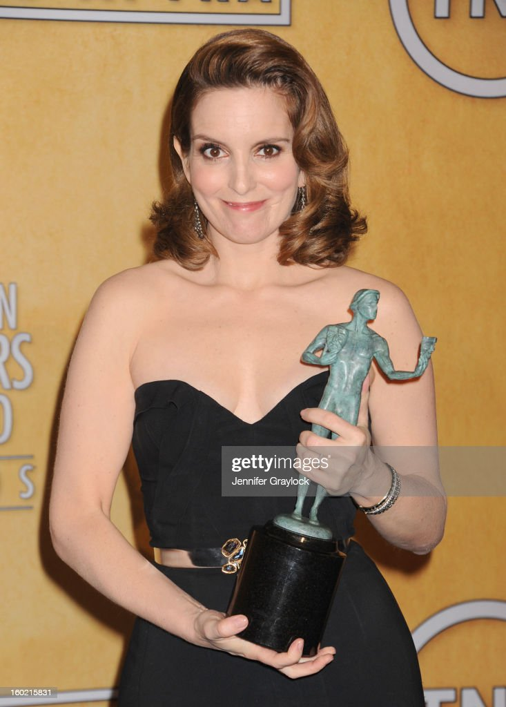 Actress <a gi-track='captionPersonalityLinkClicked' href=/galleries/search?phrase=Tina+Fey&family=editorial&specificpeople=206753 ng-click='$event.stopPropagation()'>Tina Fey</a> poses in the press room at the 19th Annual Screen Actors Guild Awards at The Shrine Auditorium on January 27, 2013 in Los Angeles, California.