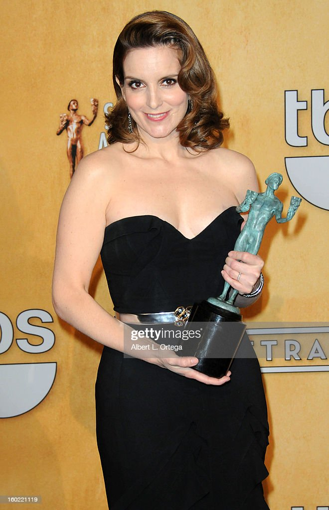 Actress <a gi-track='captionPersonalityLinkClicked' href=/galleries/search?phrase=Tina+Fey&family=editorial&specificpeople=206753 ng-click='$event.stopPropagation()'>Tina Fey</a> poses in the press room at the 19th Annual Screen Actors Guild Awards held at The Shrine Auditorium on January 27, 2013 in Los Angeles, California.