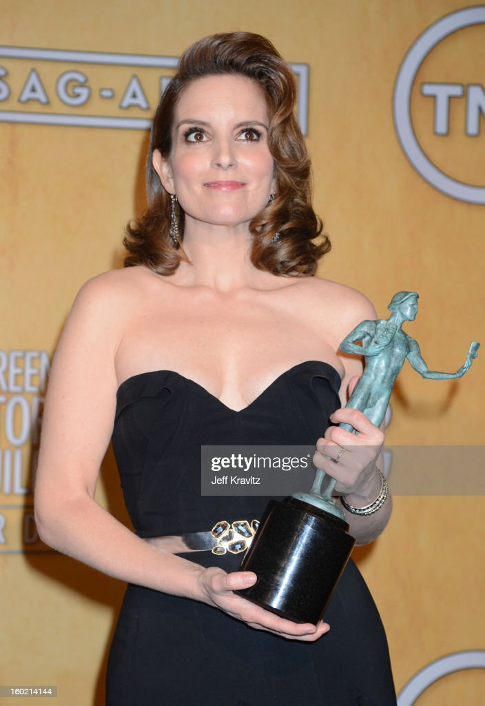 Actress <a gi-track='captionPersonalityLinkClicked' href=/galleries/search?phrase=Tina+Fey&family=editorial&specificpeople=206753 ng-click='$event.stopPropagation()'>Tina Fey</a> poses in the press room during the 19th Annual Screen Actors Guild Awards held at The Shrine Auditorium on January 27, 2013 in Los Angeles, California.