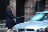 Actress Tina Fey retrieves a baseball bat from a dumpster and smashes a car windshield with it at Ed Sullivan Theater on January 5 2012 in New York...
