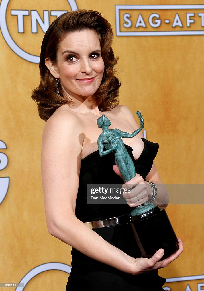 Actress <a gi-track='captionPersonalityLinkClicked' href=/galleries/search?phrase=Tina+Fey&family=editorial&specificpeople=206753 ng-click='$event.stopPropagation()'>Tina Fey</a>, winner of Outstanding Performance by a Female Actor in a Comedy Series for '30 Rock,' poses in the press room at the 19th Annual Screen Actors Guild Awards at the Shrine Auditorium on January 27, 2013 in Los Angeles, California.