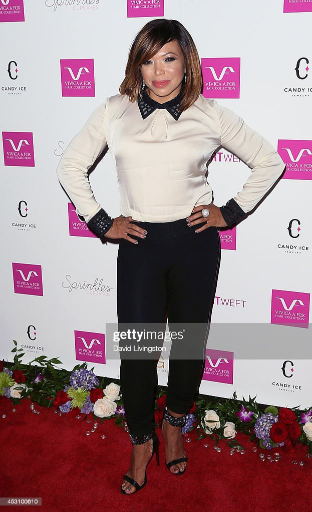 Actress <a gi-track='captionPersonalityLinkClicked' href=/galleries/search?phrase=Tisha+Campbell-Martin&family=editorial&specificpeople=241211 ng-click='$event.stopPropagation()'>Tisha Campbell-Martin</a> attends the Vivica A. Fox 50th birthday celebration at Philippe Chow on August 2, 2014 in Beverly Hills, California.