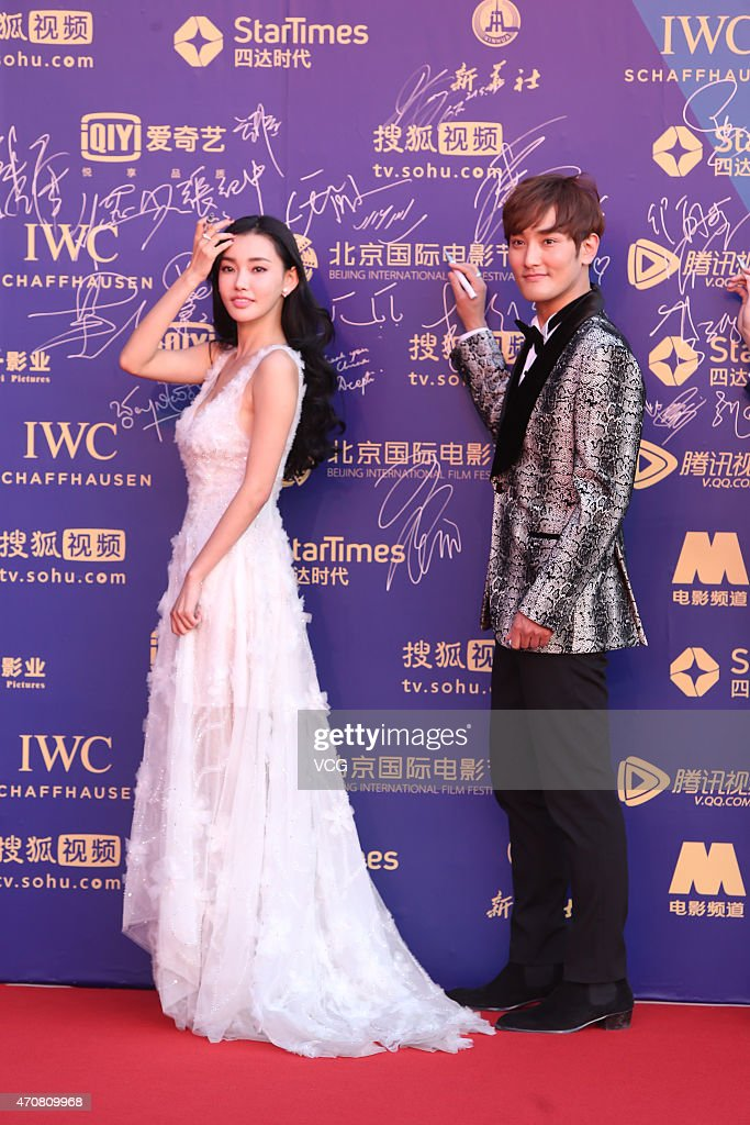 Actress Tong Fei and singer/actor Kang Ta walk the red carpet during the closing ceremony of the 5th Beijing International Film Festival at Beijing...