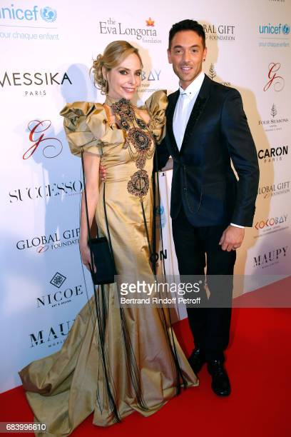 Actress Tonya Kinzinger and Dancer Maxime Dereymez attend the 'Global Gift the Eva Foundation' Gala Photocall at Hotel George V on May 16 2017 in...