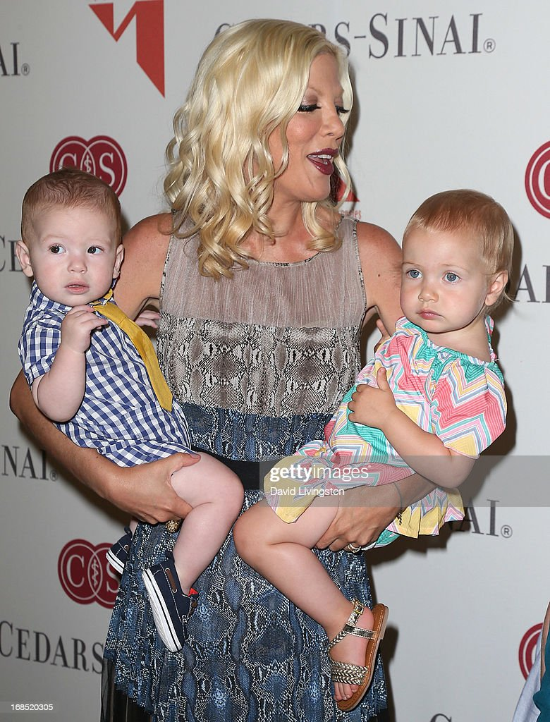 Actress Tori Spelling and children Finn Davey McDermott (L) and Hattie Margaret McDermott attend The Helping Hand of Los Angeles' Annual Mother's Day Luncheon at the Beverly Hills Hotel on May 10, 2013 in Beverly Hills, California.