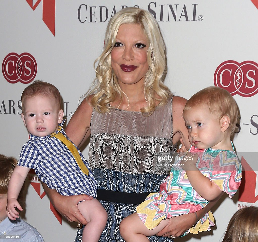 Actress <a gi-track='captionPersonalityLinkClicked' href=/galleries/search?phrase=Tori+Spelling&family=editorial&specificpeople=202560 ng-click='$event.stopPropagation()'>Tori Spelling</a> and children Finn Davey McDermott (L) and Hattie Margaret McDermott attend The Helping Hand of Los Angeles' Annual Mother's Day Luncheon at the Beverly Hills Hotel on May 10, 2013 in Beverly Hills, California.