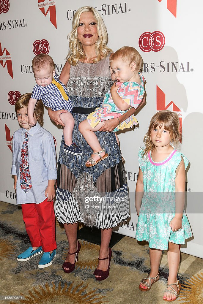 Actress <a gi-track='captionPersonalityLinkClicked' href=/galleries/search?phrase=Tori+Spelling&family=editorial&specificpeople=202560 ng-click='$event.stopPropagation()'>Tori Spelling</a> (C) and children (L-R) Liam Aaron McDermott, Finn Davey McDermott, Hattie Margaret McDermott and <a gi-track='captionPersonalityLinkClicked' href=/galleries/search?phrase=Stella+Doreen+McDermott&family=editorial&specificpeople=5632966 ng-click='$event.stopPropagation()'>Stella Doreen McDermott</a> attend The Helping Hand of Los Angeles annual mother's day luncheon at Beverly Hills Hotel on May 10, 2013 in Beverly Hills, California.