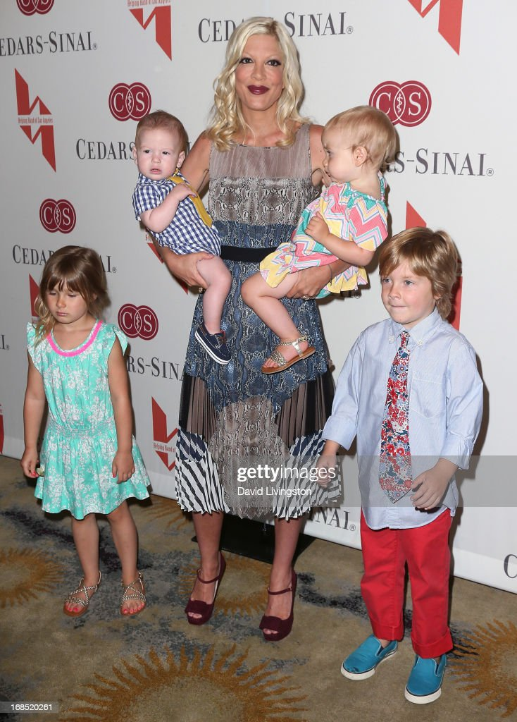 Actress <a gi-track='captionPersonalityLinkClicked' href=/galleries/search?phrase=Tori+Spelling&family=editorial&specificpeople=202560 ng-click='$event.stopPropagation()'>Tori Spelling</a> and children (L-R) <a gi-track='captionPersonalityLinkClicked' href=/galleries/search?phrase=Stella+Doreen+McDermott&family=editorial&specificpeople=5632966 ng-click='$event.stopPropagation()'>Stella Doreen McDermott</a>, Finn Davey McDermott, Hattie Margaret McDermott and Liam Aaron McDermott attend The Helping Hand of Los Angeles' Annual Mother's Day Luncheon at the Beverly Hills Hotel on May 10, 2013 in Beverly Hills, California.