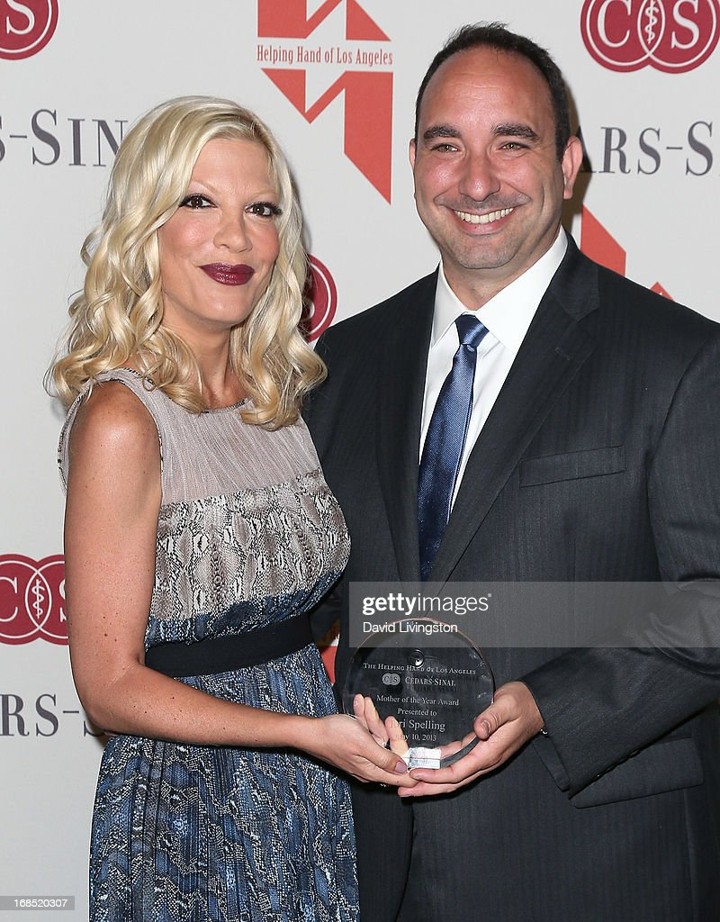Actress <a gi-track='captionPersonalityLinkClicked' href=/galleries/search?phrase=Tori+Spelling&family=editorial&specificpeople=202560 ng-click='$event.stopPropagation()'>Tori Spelling</a> (L) and Dr. Jason Rothbart attend The Helping Hand of Los Angeles' Annual Mother's Day Luncheon at the Beverly Hills Hotel on May 10, 2013 in Beverly Hills, California.
