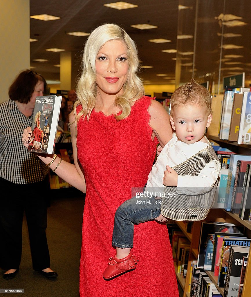 Actress <a gi-track='captionPersonalityLinkClicked' href=/galleries/search?phrase=Tori+Spelling&family=editorial&specificpeople=202560 ng-click='$event.stopPropagation()'>Tori Spelling</a> and Finn McDermott at the signing for her new book 'Spelling It Like It Is' at the Barnes & Noble bookstore at The Grove on November 9, 2013 in Los Angeles, California.
