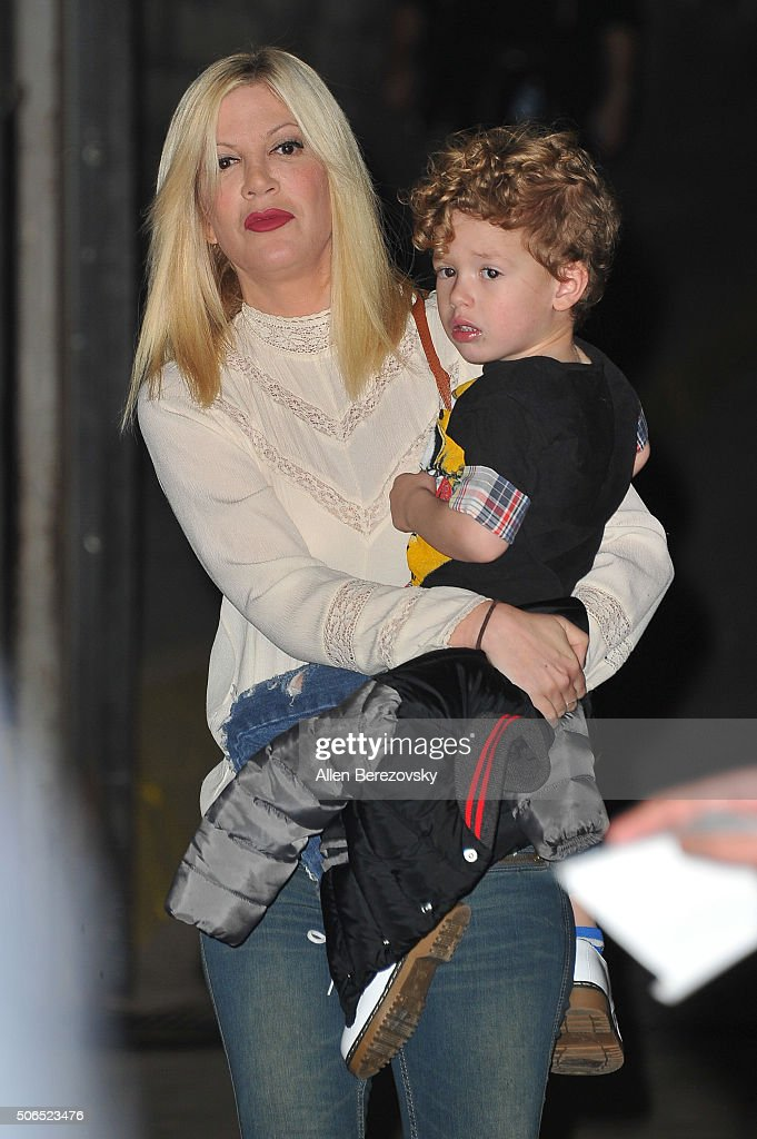 Actress Tori Spelling and son Fin McDermott attend Monster Energy Supercross at Angel Stadium of Anaheim on January 23 2016 in Anaheim California