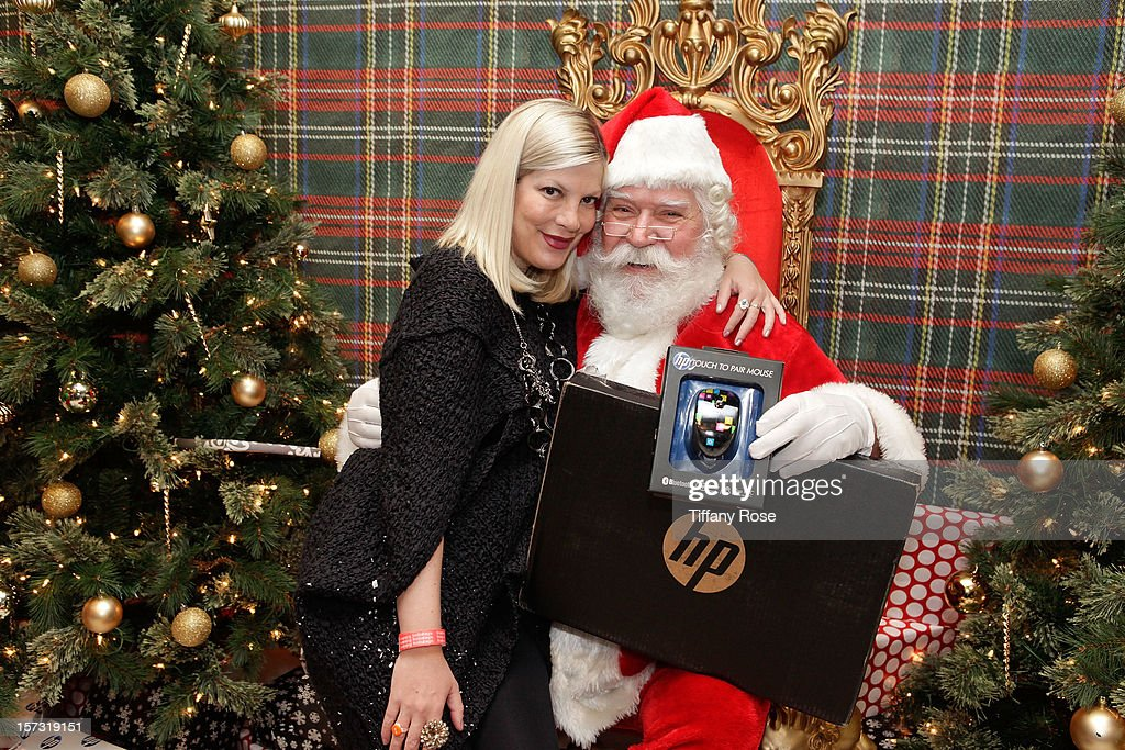 Actress <a gi-track='captionPersonalityLinkClicked' href=/galleries/search?phrase=Tori+Spelling&family=editorial&specificpeople=202560 ng-click='$event.stopPropagation()'>Tori Spelling</a> attends the 2nd Annual Santa's Secret Workshop Benefiting L.A. Family Housing at Andaz on December 1, 2012 in West Hollywood, California.