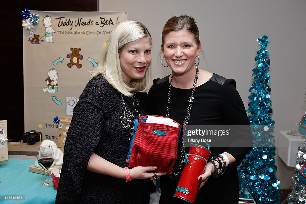 Actress <a gi-track='captionPersonalityLinkClicked' href=/galleries/search?phrase=Tori+Spelling&family=editorial&specificpeople=202560 ng-click='$event.stopPropagation()'>Tori Spelling</a> (L) attends the 2nd Annual Santa's Secret Workshop Benefiting L.A. Family Housing at Andaz on December 1, 2012 in West Hollywood, California.