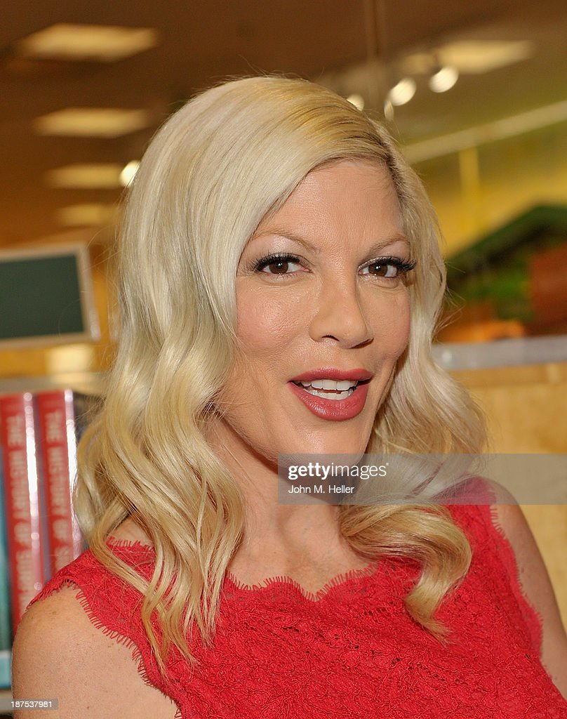 Actress <a gi-track='captionPersonalityLinkClicked' href=/galleries/search?phrase=Tori+Spelling&family=editorial&specificpeople=202560 ng-click='$event.stopPropagation()'>Tori Spelling</a> attends the book signing for her new book at the Barnes & Noble bookstore at The Grove on November 9, 2013 in Los Angeles, California.
