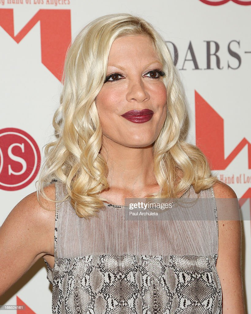 Actress <a gi-track='captionPersonalityLinkClicked' href=/galleries/search?phrase=Tori+Spelling&family=editorial&specificpeople=202560 ng-click='$event.stopPropagation()'>Tori Spelling</a> attends the Helping Hand of Los Angeles' 84th annual Mother's Day luncheon at the Beverly Hills Hotel on May 10, 2013 in Beverly Hills, California.
