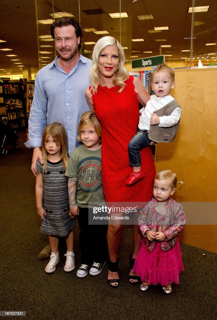 Actress <a gi-track='captionPersonalityLinkClicked' href=/galleries/search?phrase=Tori+Spelling&family=editorial&specificpeople=202560 ng-click='$event.stopPropagation()'>Tori Spelling</a>, her husband <a gi-track='captionPersonalityLinkClicked' href=/galleries/search?phrase=Dean+McDermott&family=editorial&specificpeople=4486413 ng-click='$event.stopPropagation()'>Dean McDermott</a> and their children (L-R) Stella McDermott, <a gi-track='captionPersonalityLinkClicked' href=/galleries/search?phrase=Liam+McDermott&family=editorial&specificpeople=4975632 ng-click='$event.stopPropagation()'>Liam McDermott</a>, Finn McDermott and Hattie McDermott pose together before Spelling signed copies of her new book 'Spelling It Like It Is' at Barnes & Noble bookstore at The Grove on November 9, 2013 in Los Angeles, California.