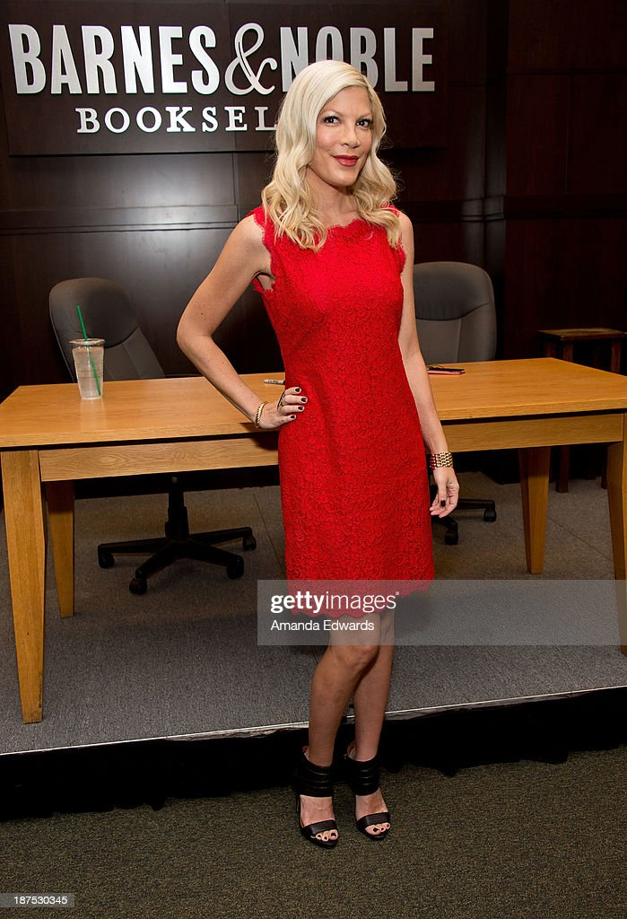 Actress <a gi-track='captionPersonalityLinkClicked' href=/galleries/search?phrase=Tori+Spelling&family=editorial&specificpeople=202560 ng-click='$event.stopPropagation()'>Tori Spelling</a> poses before signing copies of her new book 'Spelling It Like It Is' at Barnes & Noble bookstore at The Grove on November 9, 2013 in Los Angeles, California.
