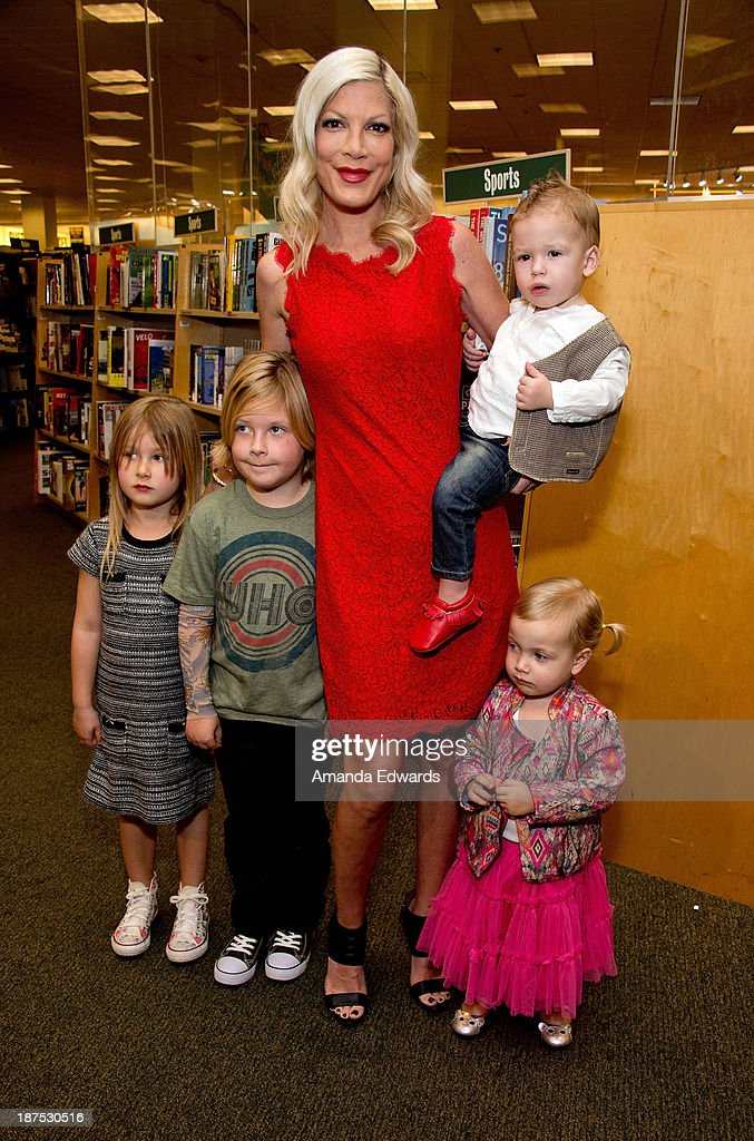 Actress Tori Spelling poses with her children (L-R) Stella McDermott, Liam McDermott, Finn McDermott and Hattie McDermott before signing copies of her new book 'Spelling It Like It Is' at Barnes & Noble bookstore at The Grove on November 9, 2013 in Los Angeles, California.
