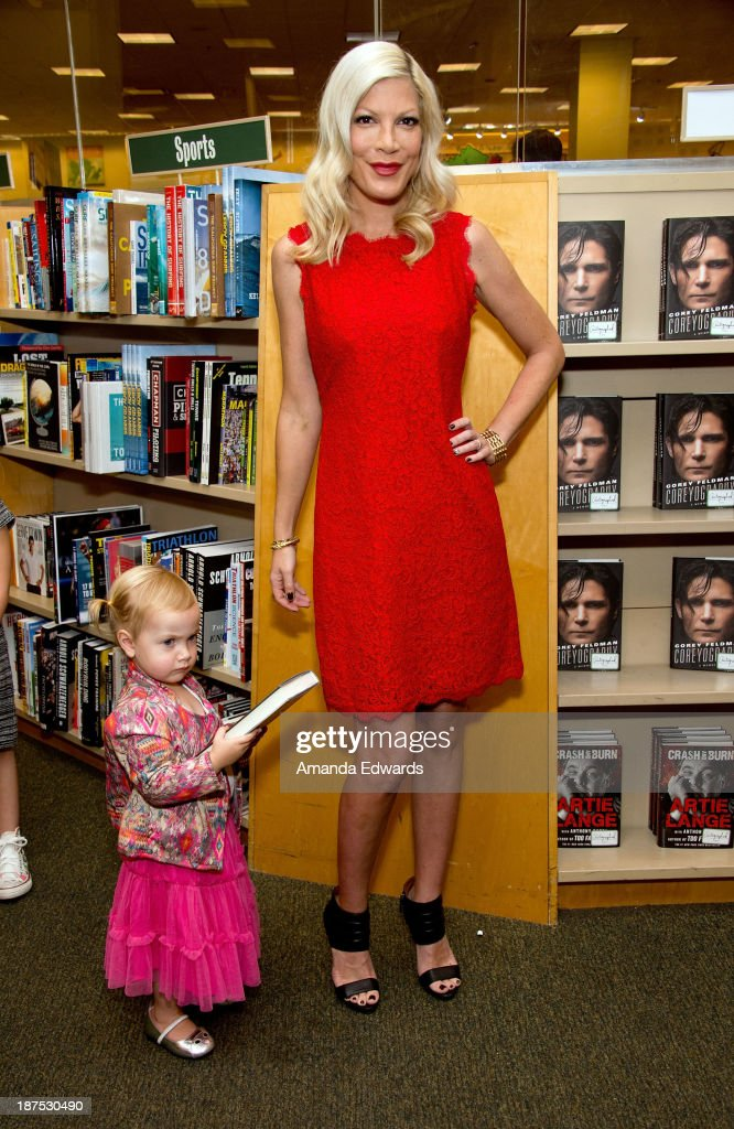 Actress <a gi-track='captionPersonalityLinkClicked' href=/galleries/search?phrase=Tori+Spelling&family=editorial&specificpeople=202560 ng-click='$event.stopPropagation()'>Tori Spelling</a> poses with her daughter Hattie McDermott before signing copies of her new book 'Spelling It Like It Is' at Barnes & Noble bookstore at The Grove on November 9, 2013 in Los Angeles, California.