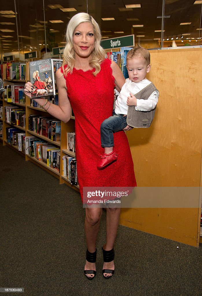 Actress <a gi-track='captionPersonalityLinkClicked' href=/galleries/search?phrase=Tori+Spelling&family=editorial&specificpeople=202560 ng-click='$event.stopPropagation()'>Tori Spelling</a> poses with her son Finn McDermott before signing copies of her new book 'Spelling It Like It Is' at Barnes & Noble bookstore at The Grove on November 9, 2013 in Los Angeles, California.