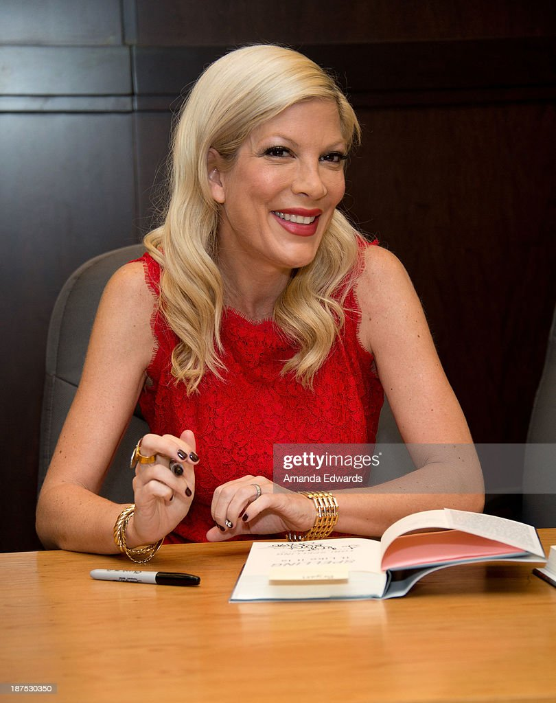 Actress <a gi-track='captionPersonalityLinkClicked' href=/galleries/search?phrase=Tori+Spelling&family=editorial&specificpeople=202560 ng-click='$event.stopPropagation()'>Tori Spelling</a> signs copies of her new book 'Spelling It Like It Is' at Barnes & Noble bookstore at The Grove on November 9, 2013 in Los Angeles, California.
