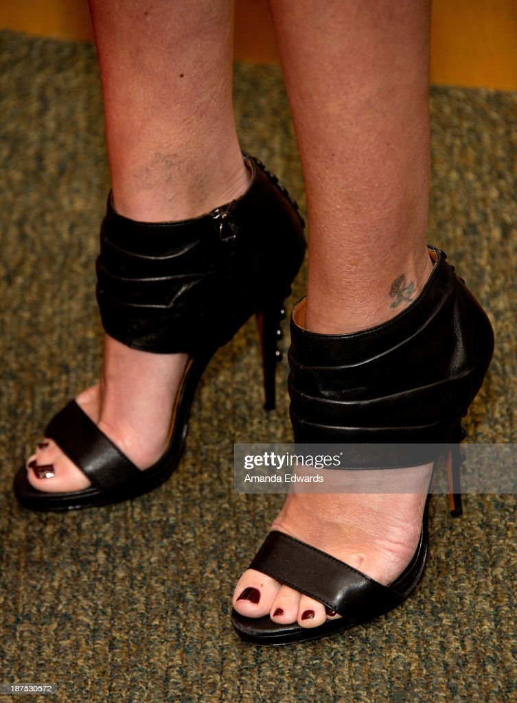 Actress <a gi-track='captionPersonalityLinkClicked' href=/galleries/search?phrase=Tori+Spelling&family=editorial&specificpeople=202560 ng-click='$event.stopPropagation()'>Tori Spelling</a> (shoe detail) signs copies of her new book 'Spelling It Like It Is' at Barnes & Noble bookstore at The Grove on November 9, 2013 in Los Angeles, California.