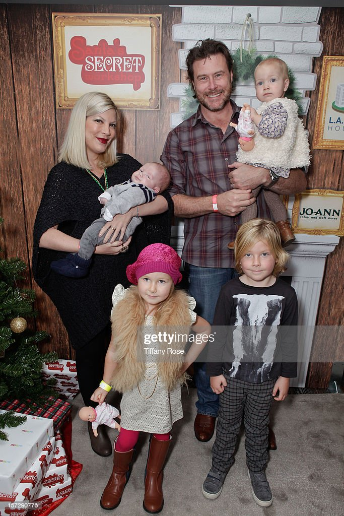Actress <a gi-track='captionPersonalityLinkClicked' href=/galleries/search?phrase=Tori+Spelling&family=editorial&specificpeople=202560 ng-click='$event.stopPropagation()'>Tori Spelling</a> with son Finn, husband <a gi-track='captionPersonalityLinkClicked' href=/galleries/search?phrase=Dean+McDermott&family=editorial&specificpeople=4486413 ng-click='$event.stopPropagation()'>Dean McDermott</a> with daughter Hattie, daughter Stella and son Liam attend the 2nd Annual Santa's Secret Workshop Benefiting L.A. Family Housing at Andaz on December 1, 2012 in West Hollywood, California.