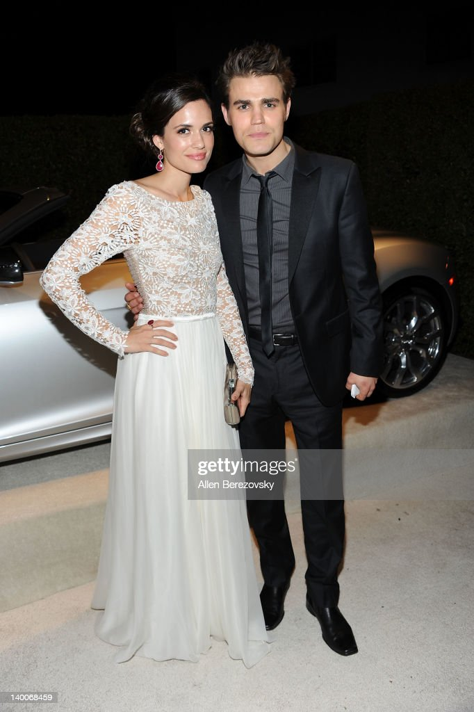 Actress <a gi-track='captionPersonalityLinkClicked' href=/galleries/search?phrase=Torrey+DeVitto&family=editorial&specificpeople=4357676 ng-click='$event.stopPropagation()'>Torrey DeVitto</a> (L) and actor <a gi-track='captionPersonalityLinkClicked' href=/galleries/search?phrase=Paul+Wesley&family=editorial&specificpeople=693176 ng-click='$event.stopPropagation()'>Paul Wesley</a> arrive at Audi Arrivals at 20th annual Elton John AIDS Foundation Academy Awards viewing party on February 26, 2012 in Beverly Hills, California.